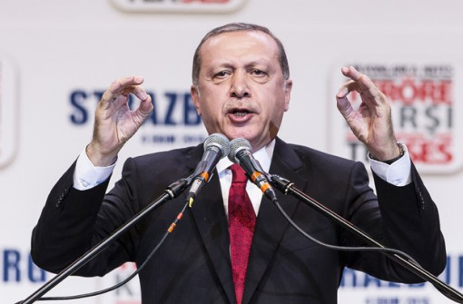 Turkey's President Recep Tayyip Erdogan gestures as he speaks to supporters of his ruling Justice and Development Party as they rally to denounce violence by Kurdish rebels, in Strasbourg, eastern France, Sunday Oct. 4, 2015. Erdogan condemned terrorism and the violence which has rocked southeastern Turkey since the resumption of fighting between the military and the Kurdistan Workers' Party, or PKK. The separatist group is considered a terror organization by the Turkey, the U.S. and the EU. (AP Photo/Jean-Francois Badias)
