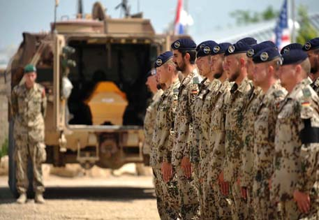 Soldiers of German armed forces Bundeswehr stand in line for fallen comrade from their unit during farewell ceremony in Kunduz
